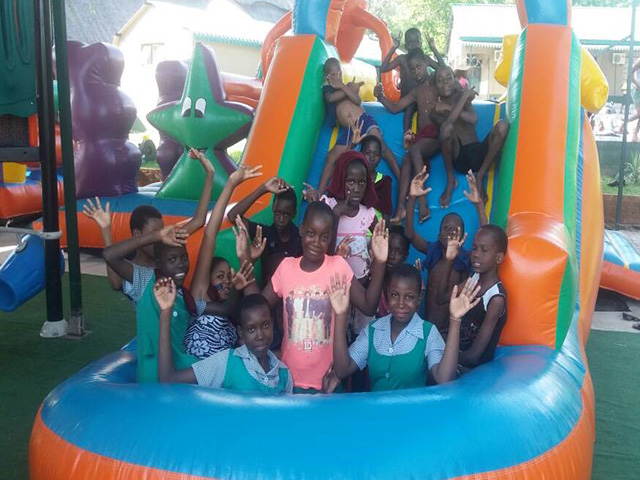 Children enjoying XMAS Party at Tamaindi Lodges <br> FUNDED BY C&C